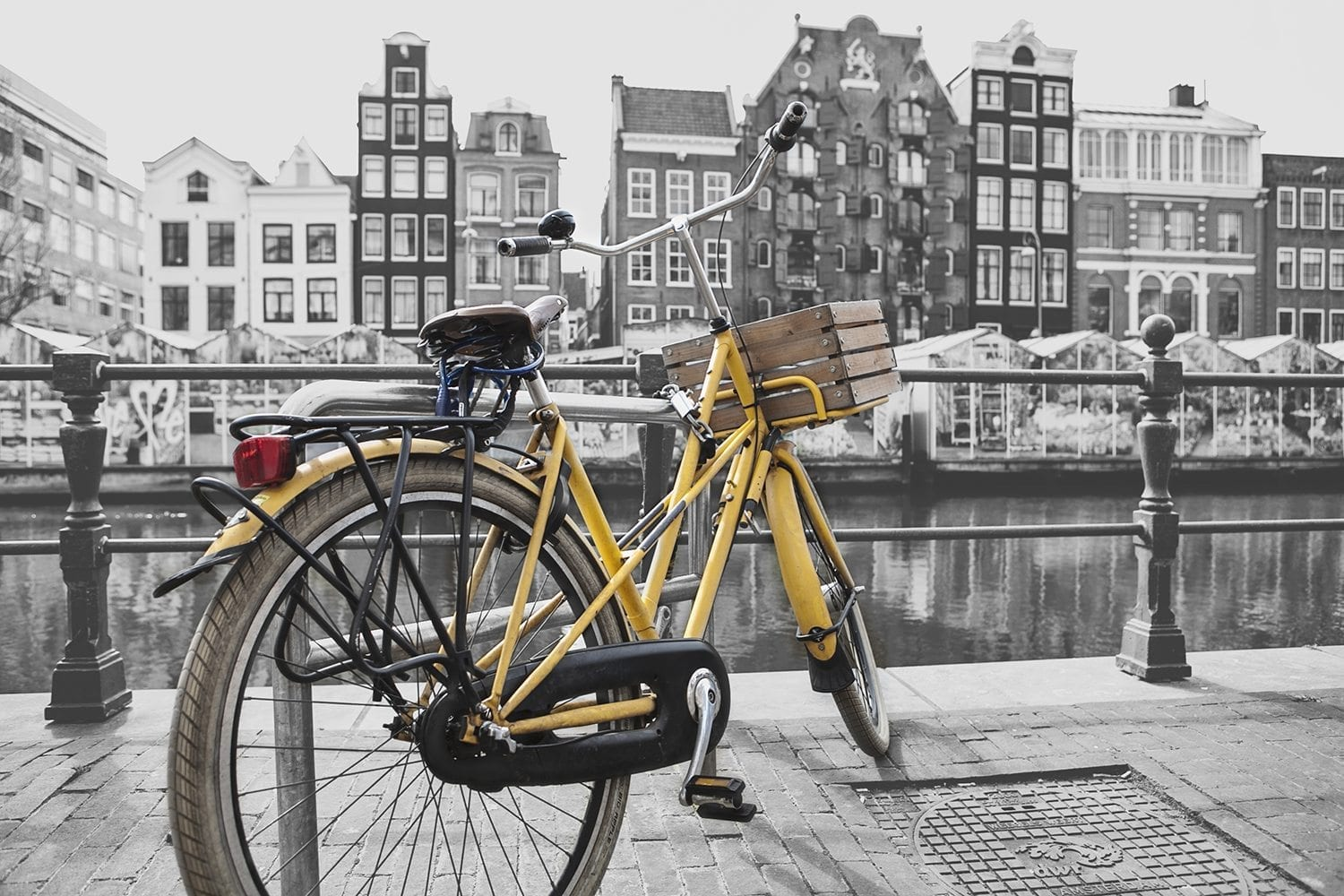yellow bike in front of amsterdam flower market
