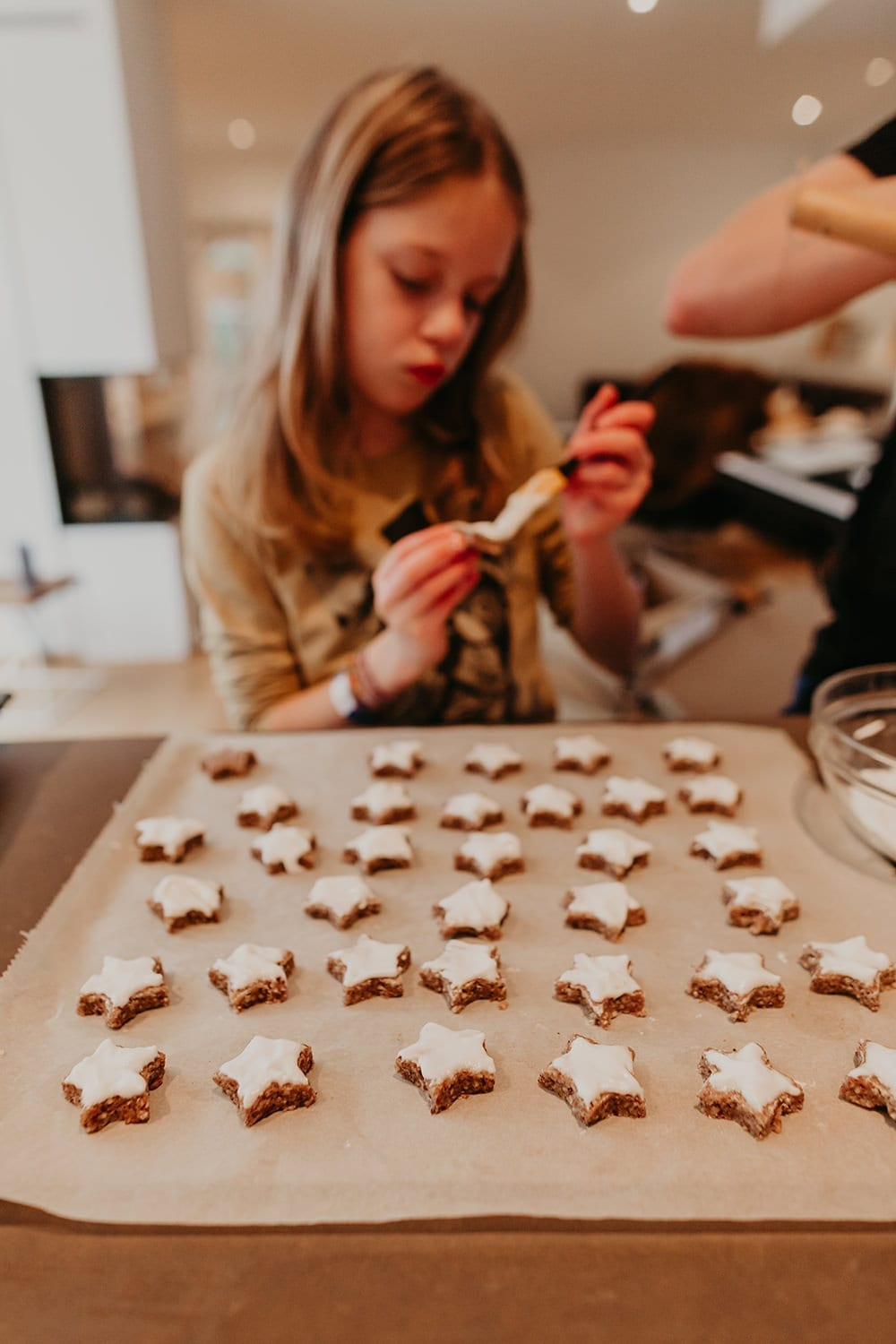 young girl baking german cinnamon stars for Christmas