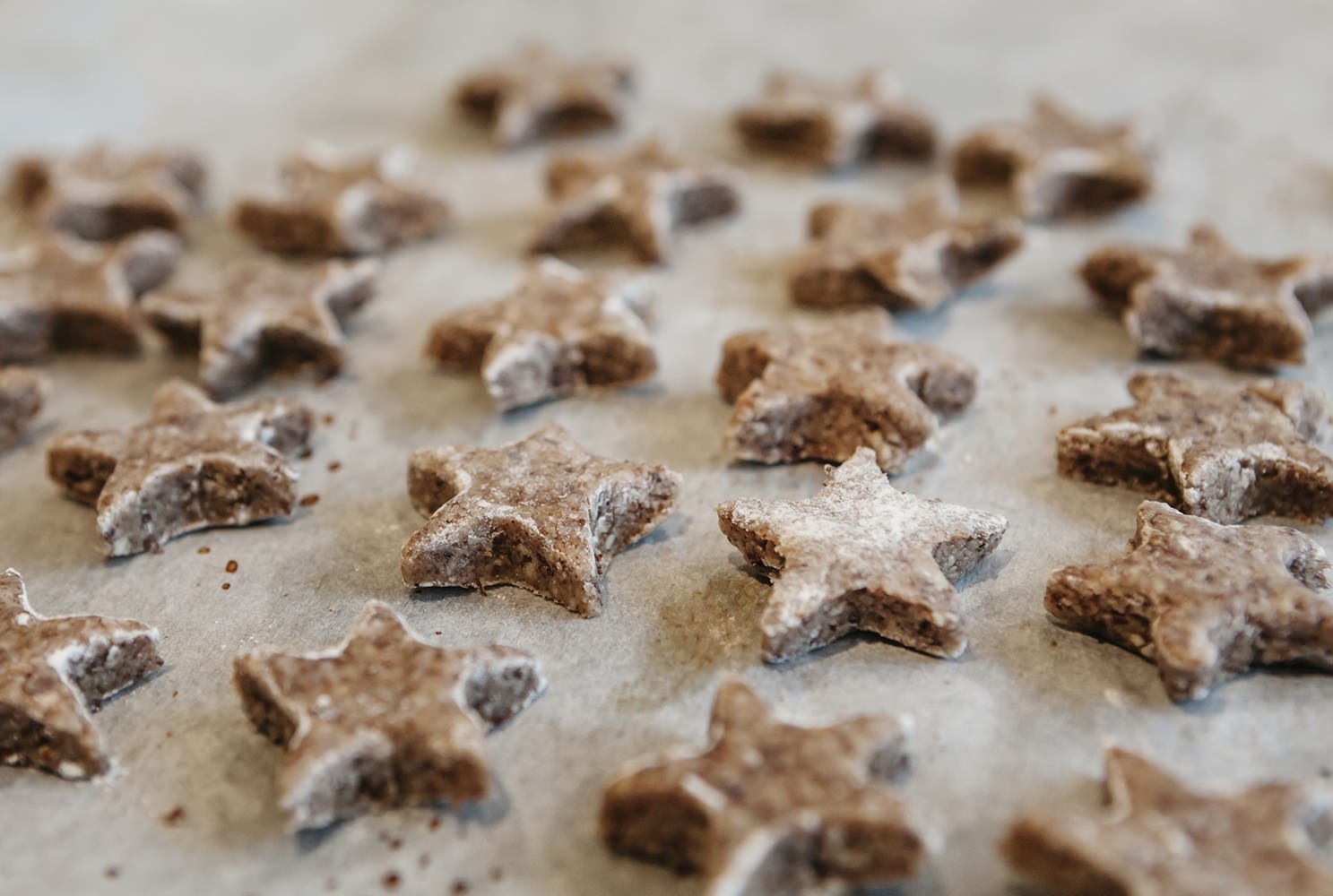 collection of homemade cinnamon star after a german recipe on a baking sheet