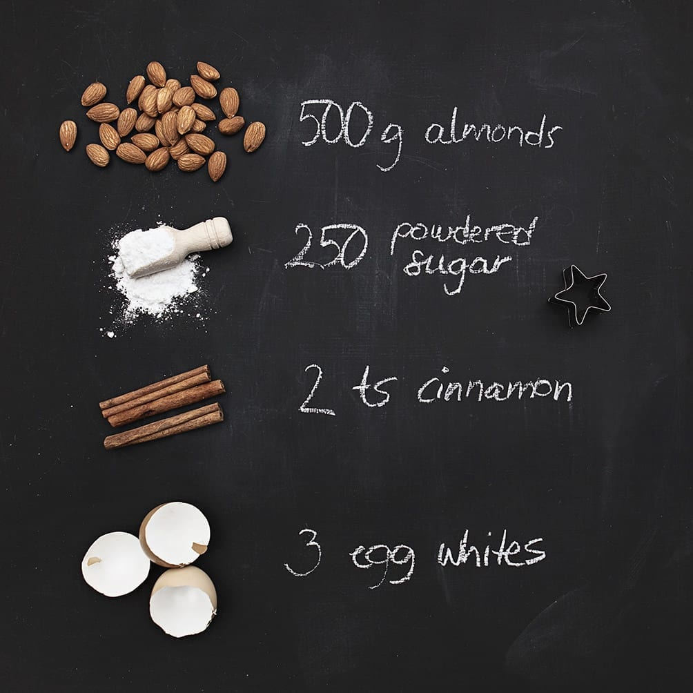 a flatlay blackboard of baking ingredients for german cinnamon stars with text