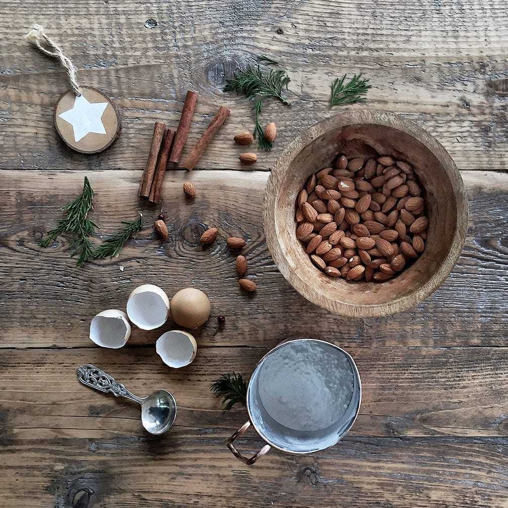 a flatlay of baking ingredients for german cinnamon stars