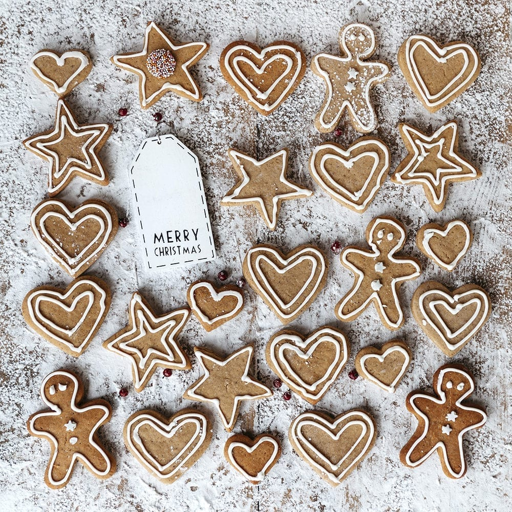 scandinavian homemade gingerbread cookies on a white background, hearts, stars and snowflakes