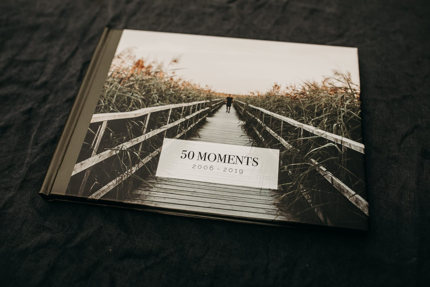 picture of a professional photo album called 50 moments with you